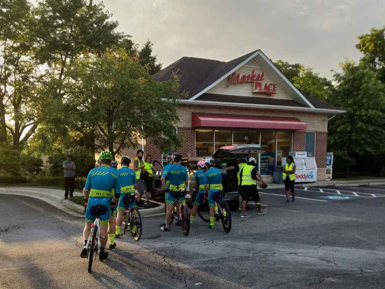 """All of Team Sea to See's riders congregating at a market at Ramm's head in Annapolis (Time Station #54) to ride the final few miles in """"parade"""" format to the RAAM finish line."""