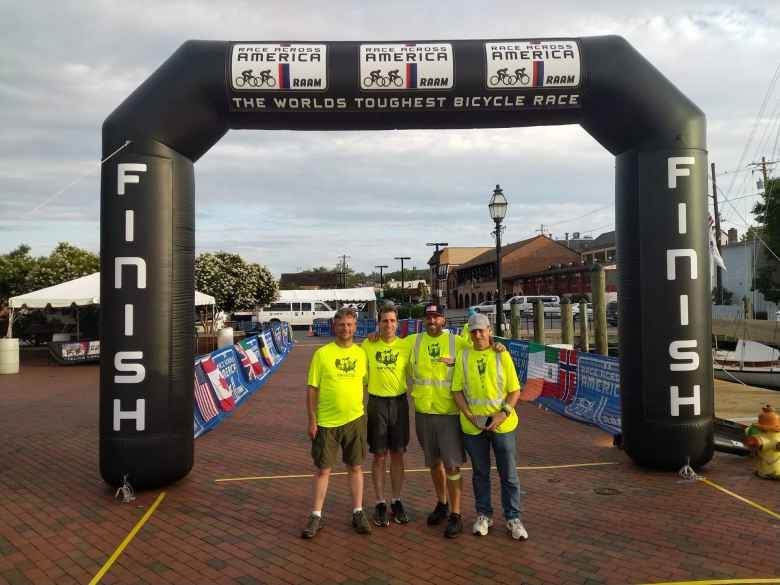 Team Sea to See's RV drivers Nate Faudel, Russ Stevens, Brad Thurman, and Matt Hannifin at the 2018 Race Across America finish line.