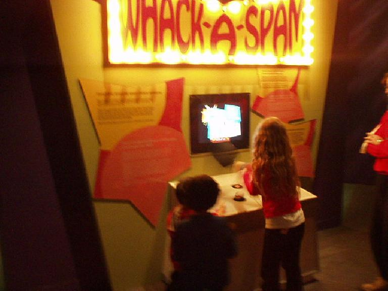 "Kathrin was down for the weekend, so we hung out and went to the Tech Museum in San Jose.  Since this was the 2nd Sunday of the month, admission turned out to be FREE! Here's a girl at the ""Whack-a-Spam"" exhibit in the Internet section."
