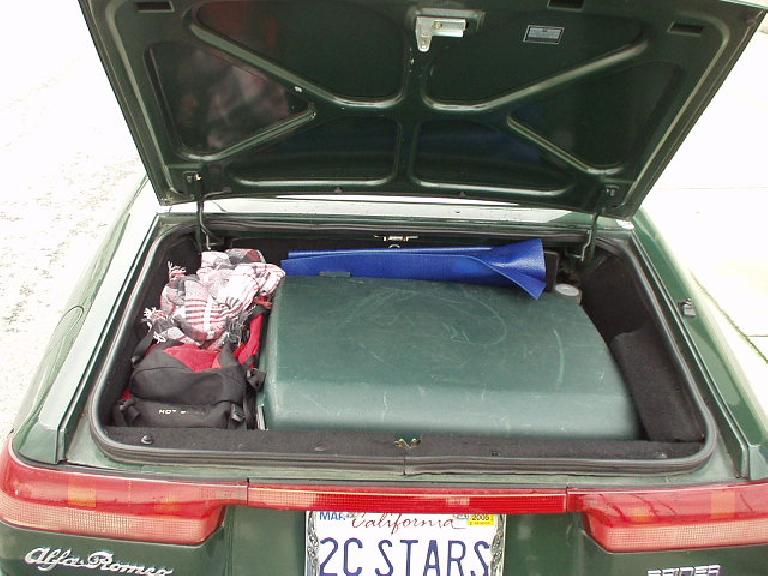 Alas a few hours later she'd have to fly back to Pittsburgh.  Here is evidence that the Alfa is a fairly practical car: it was able to fit her big suitcase in the trunk!  This is certainly the largest trunk I've
