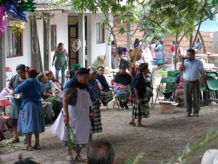 Older ladies dancing while a loud band was tooting horns.