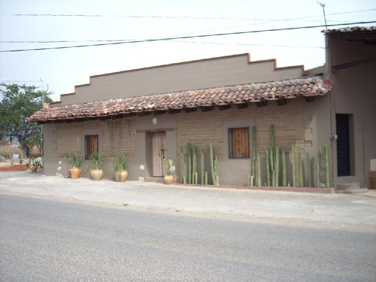 House with cacti.