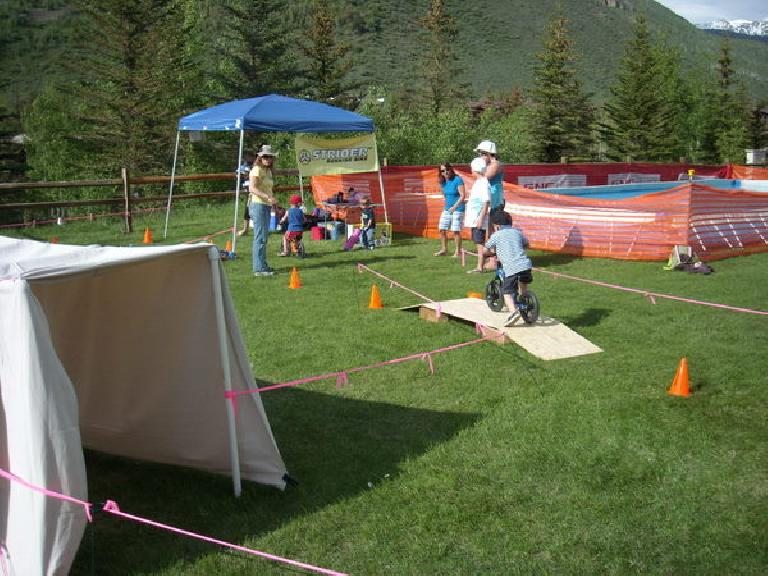 Kids riding an obstacle course.