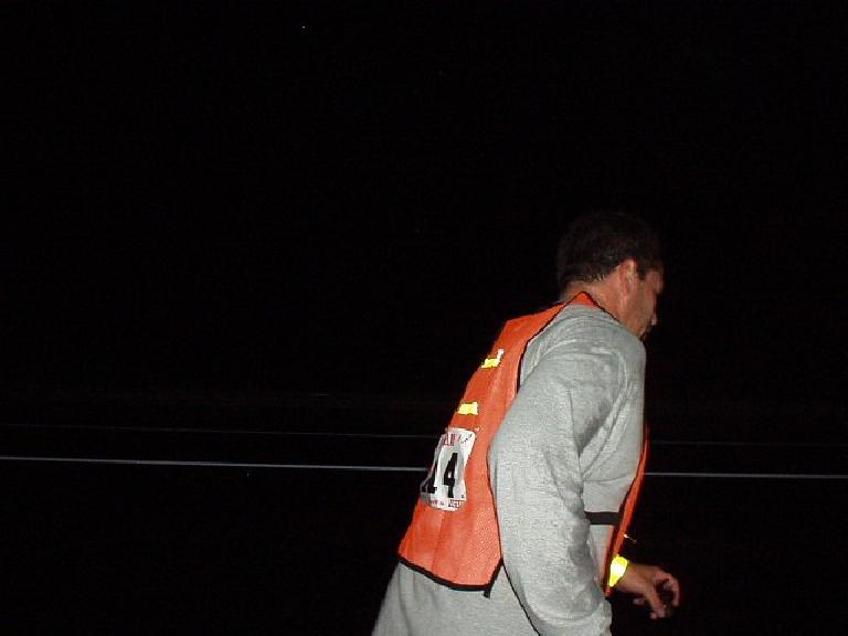7:27 p.m., Mile 47: Ron passing our van partway through his 5.6-mile leg.  Now it is totally dark.