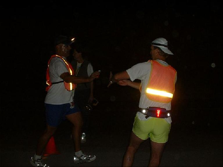 Herb makes a handoff to Steve during the darkness on his 2nd leg. Photo: Tom Erceg. (October 12, 2003)