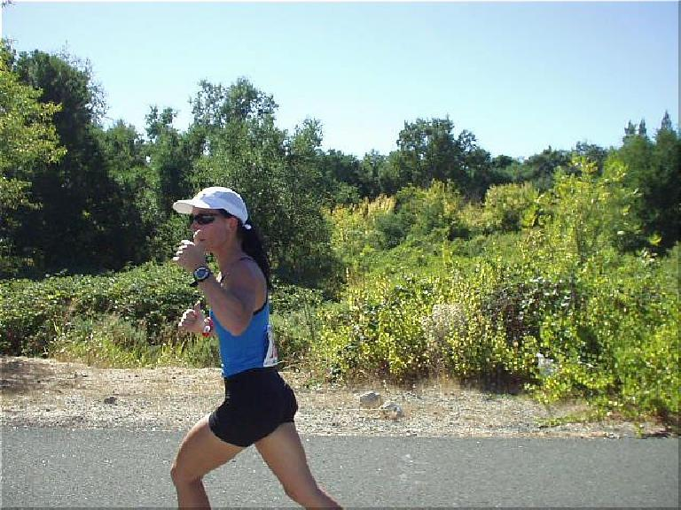[Mile 10, 1:35 elasped, 2:05 p.m.] Here's Lisa on the third leg, giving a thumbs up.  By this time it was really roasting outside, and she still did great.