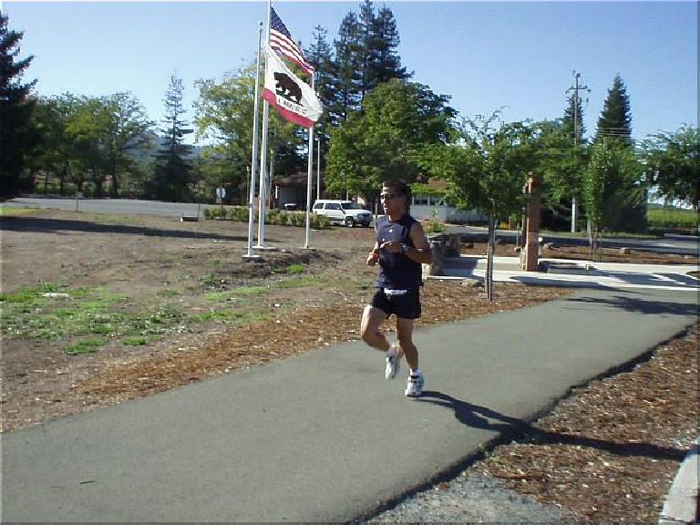 [Mile 23, 3:07 elasped, 3:37pm] Here's Mike running underneath the stars and stripes and the California flag.