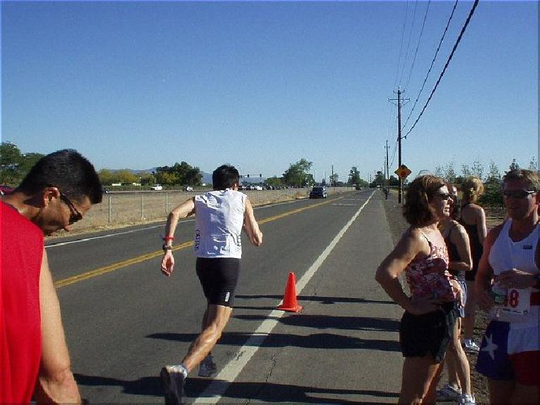 [Mile 26, 3:35 elasped, 4:05pm] Here's Everitt taking off right after grabbing the baton (actually an elastic wrist band) from Mike.