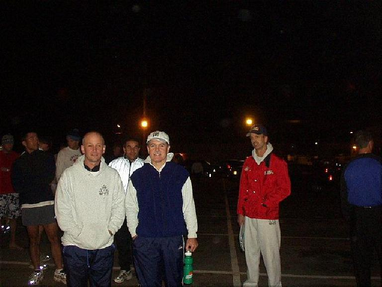 [Mile 105, 14:19 elasped, 2:49 a.m.] After we in Van #1 ran our 2nd legs, we met the other van at the van exchange just south of the Golden Gate Bridge.  Here's Tom, Al (background), Phil, and Steve during a beautiful night of a full moon and perfect running temps. (October 12, 2003)