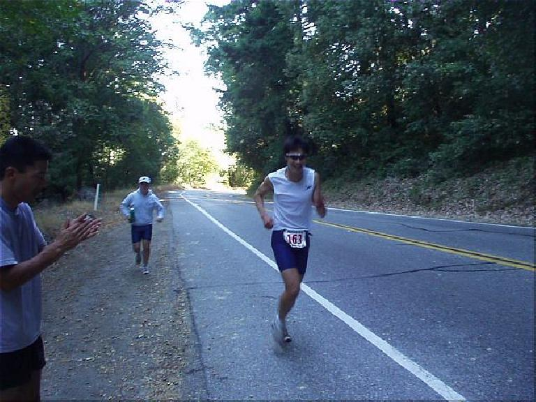 [Mile 164, 22:44 elasped, 11:14 a.m.] Here's Everitt midway up the gruelling, all-uphill leg  on Highway 9 from Redwood Gulch to Saratoga Gap. (October 12, 2003)