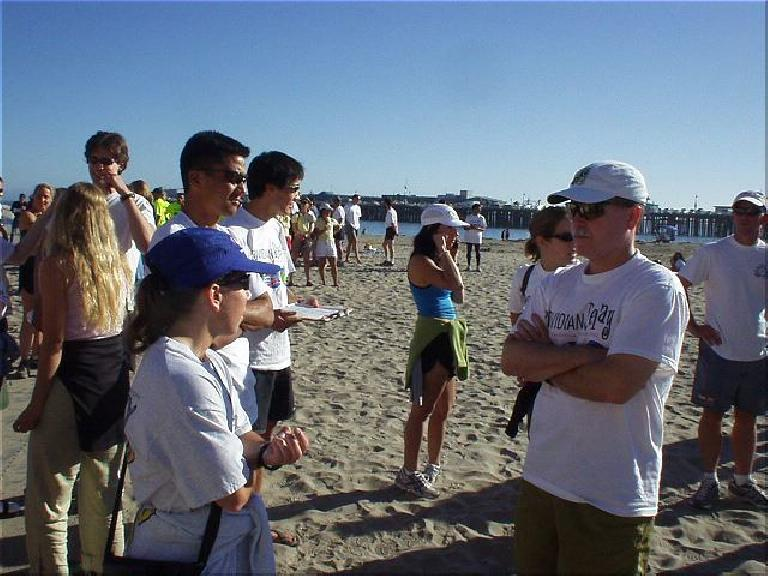 [Mile 199, 27:54 elasped, 4:24 p.m.] After almost 28 hours, wwe made it to the Boardwalk in Santa Cruz!  This is Sharon, Mike, Everitt, Lisa, Heidi, and Phil awaiting Manuel's arrival! (October 12, 2003)