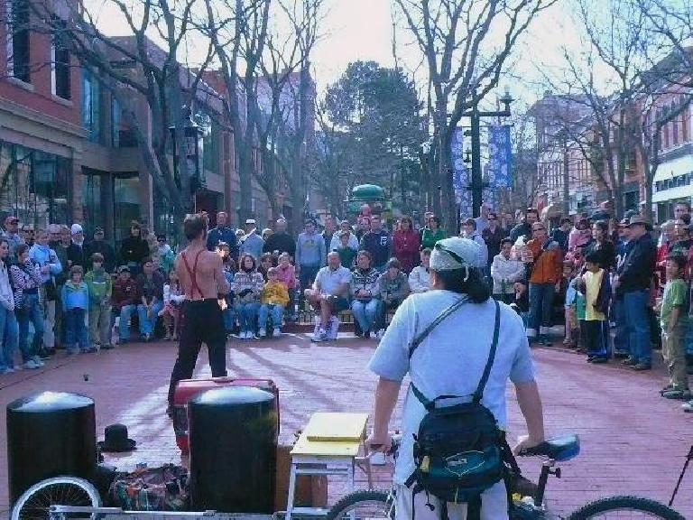 A crowd gathered around a flame juggler at Pearl Street Mall in Boulder. (March 15, 2008)