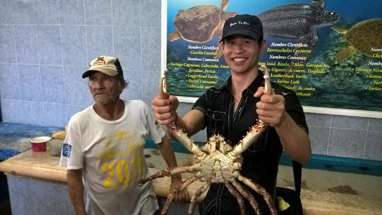 Felix Wong holding a giant crab