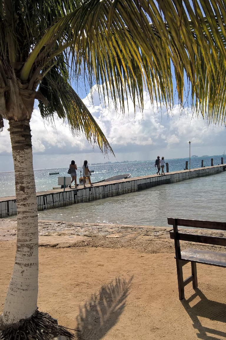 tourists walking along pier outside Tortungranja in Isla Mujeres