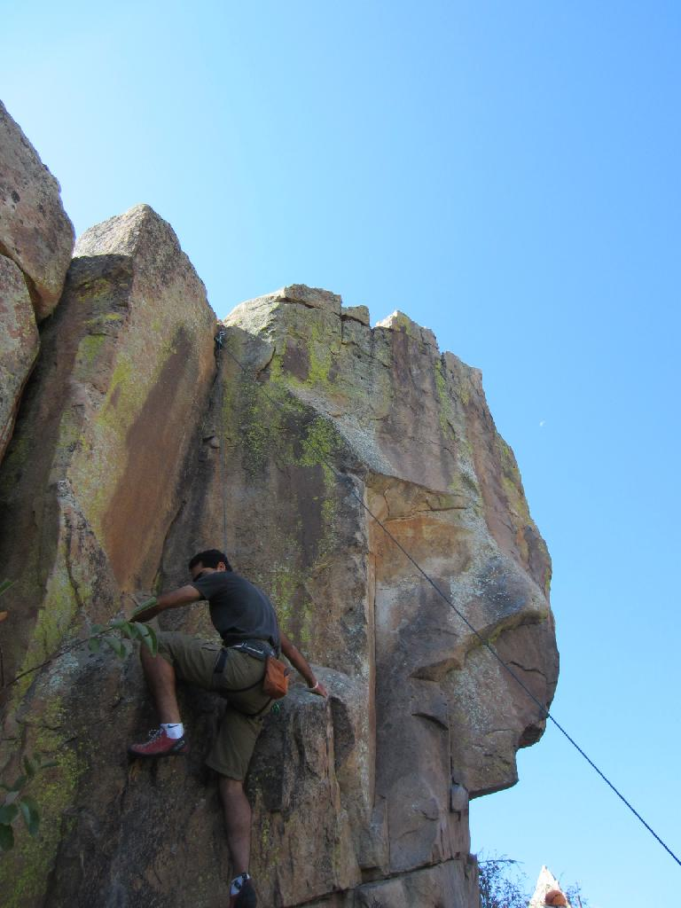Mehdi climbing over a ledge that lead to a crack climb at the Torture Chamber. (September 9, 2012)