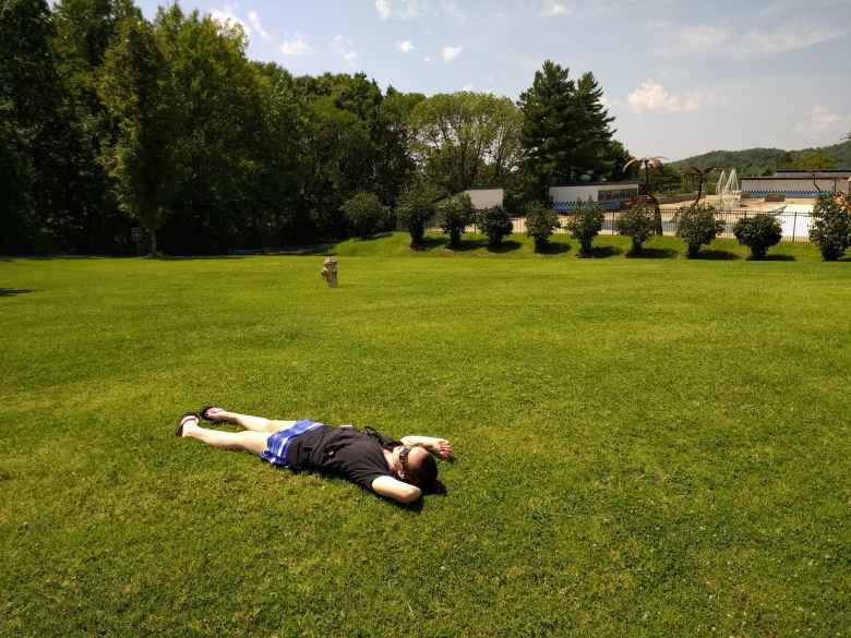 Maureen watching the total solar eclipse on grass near the Union Hills Golf Course in Pevely, Missouri.