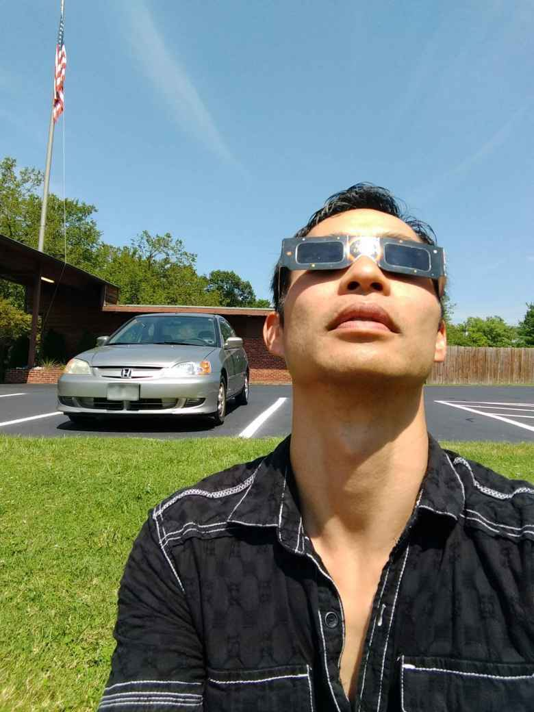 American flag, flagpole, silver Honda Civic, Felix Wong, American Paper Optics eclipse glasses