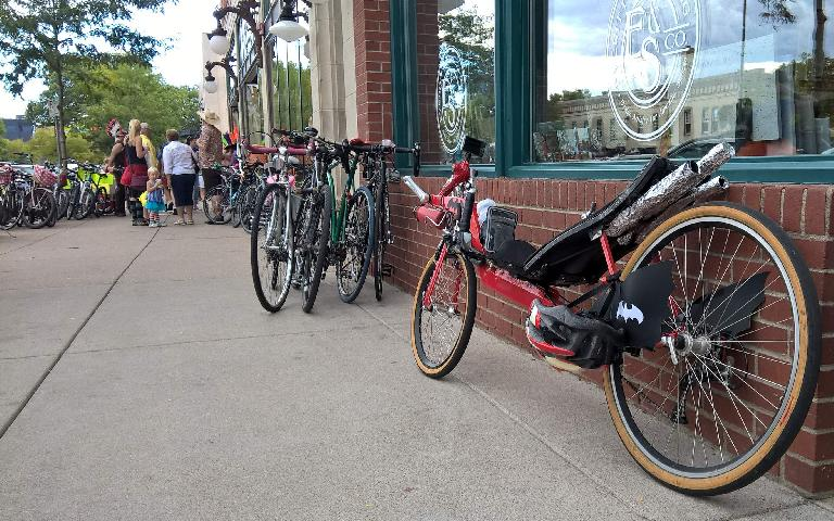 "My red Reynolds Wishbone recumbent ""Batcycle"" with many other bikes along Mountain Ave. near the Rio Grande Restaurant."