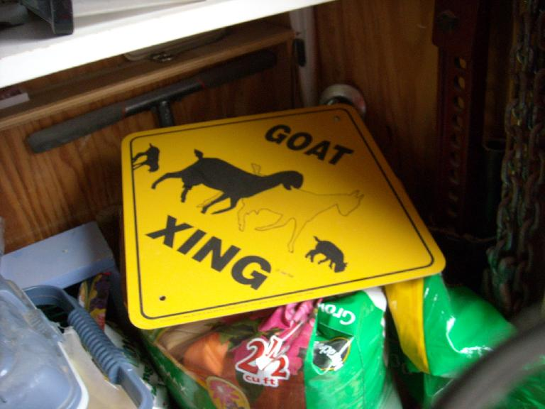 """""""Goat xing.""""  There were no goats around but perhaps the chicken owner had plans for goats in the future."""