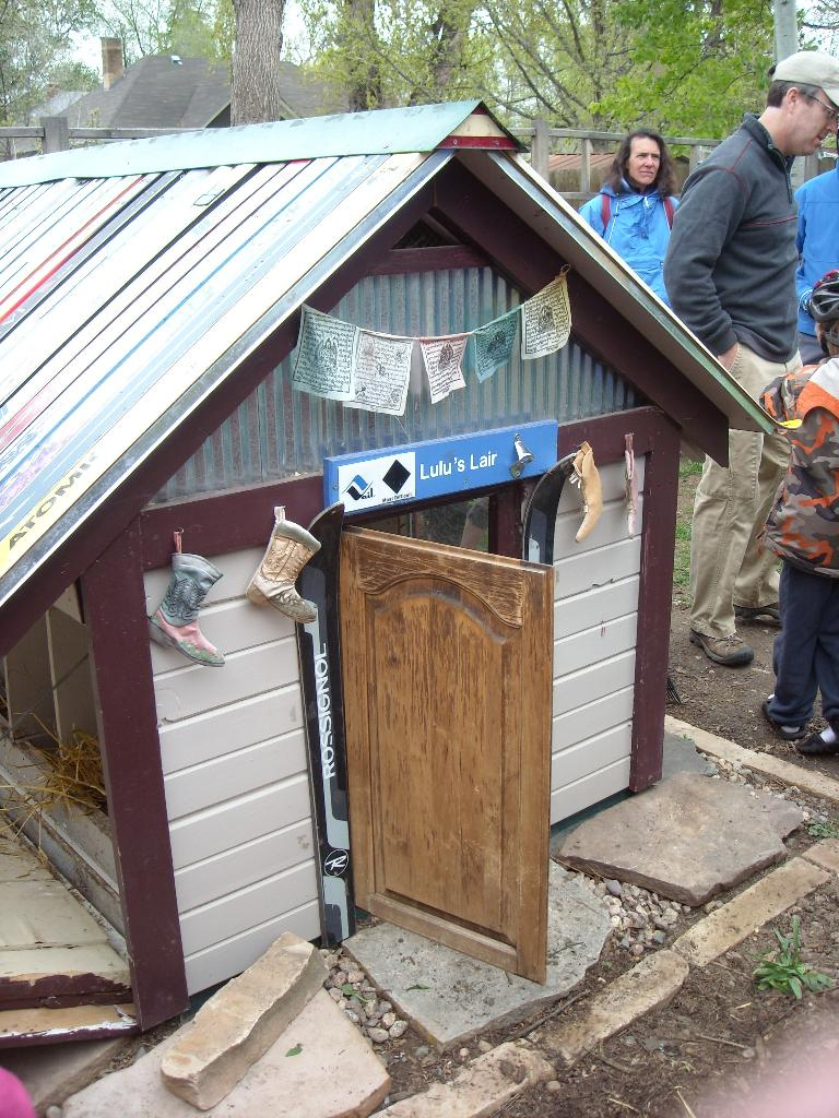 """The owner of the mobile chicken coop also had a permanent one at his home, using recycled skis for the roof.  This is """"Lulu's Lair."""""""