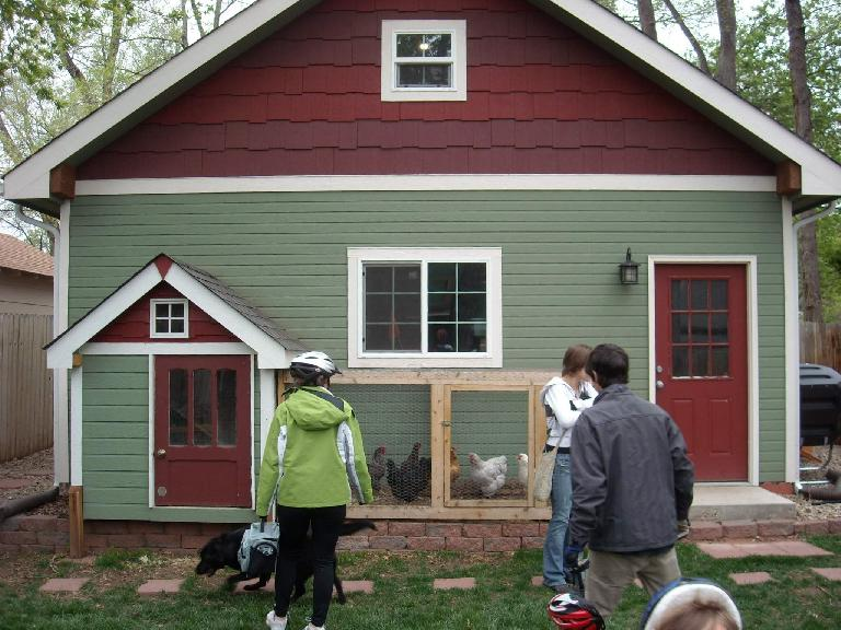 The owner of this house had a friend build a chicken coop that matched the house exactly.