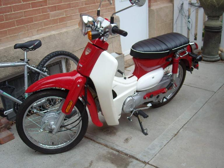 "I was talking with Ted (a participant in the tour) about Honda Dreams (""the best selling vehicle of all time""), and by coincidence, at the next chicken coop was this Sym Symba—a Honda Dream knockoff."