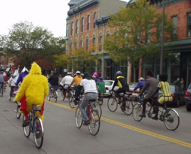 Big Bird bikes through Old Town.