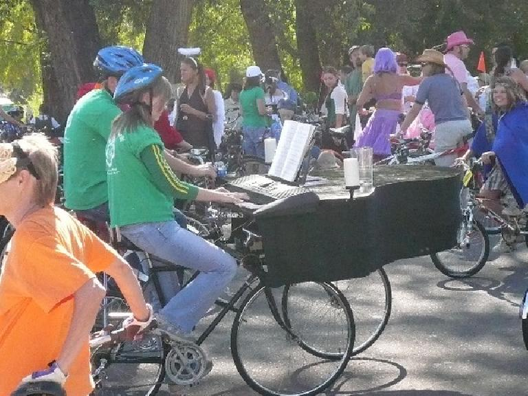 These two people played the piano while they rode.