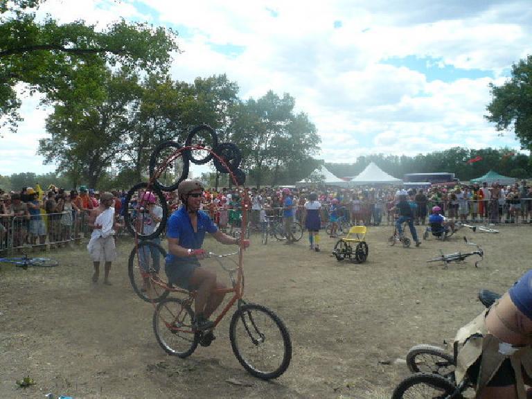 On the seven-wheeled bike.