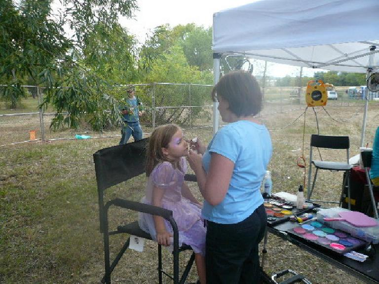 Faith getting face-painted.