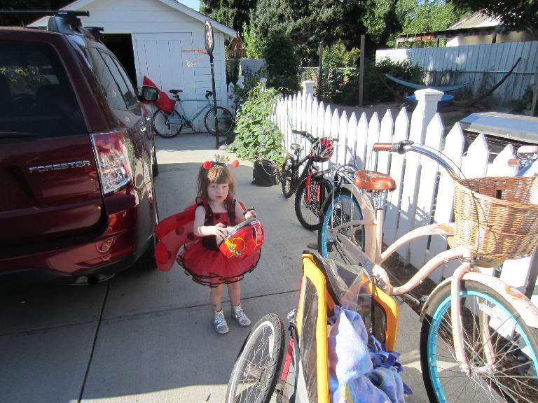 Zoe putting on her helmet.