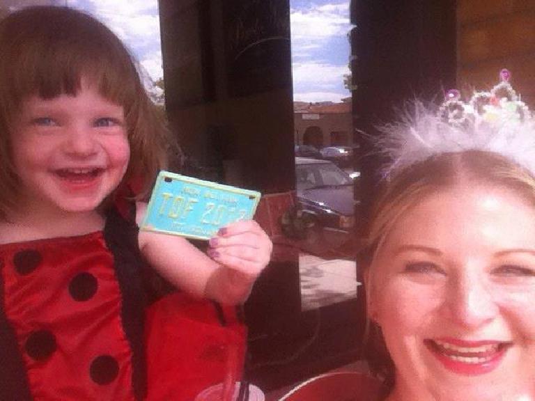 Zoe and mama got a Tour de Fat license plate! Photo: Charis Ackerson.