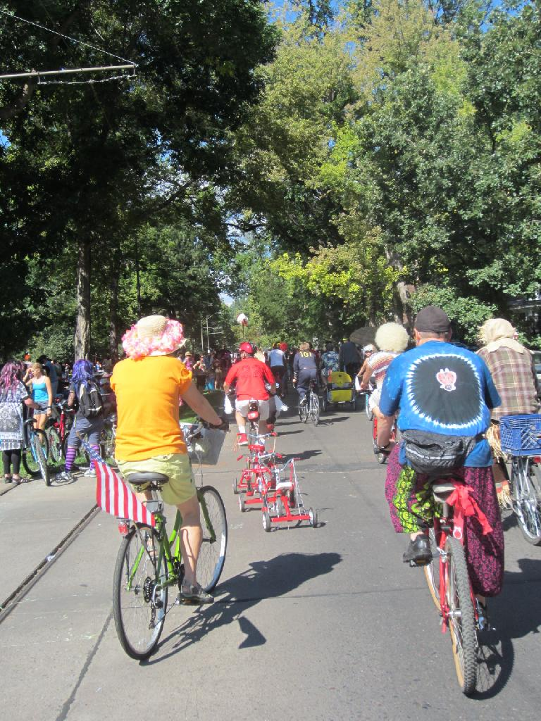 Following a stringed-together line of of tricycles.