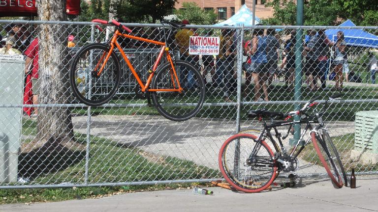 Bicycles on the fence surrounding the main Tour de Fat festival area.