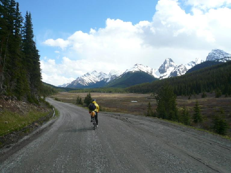 Day 1: Riding mostly uphill by the Canadian Rockies with fellow racer Kevin Hall (shown).