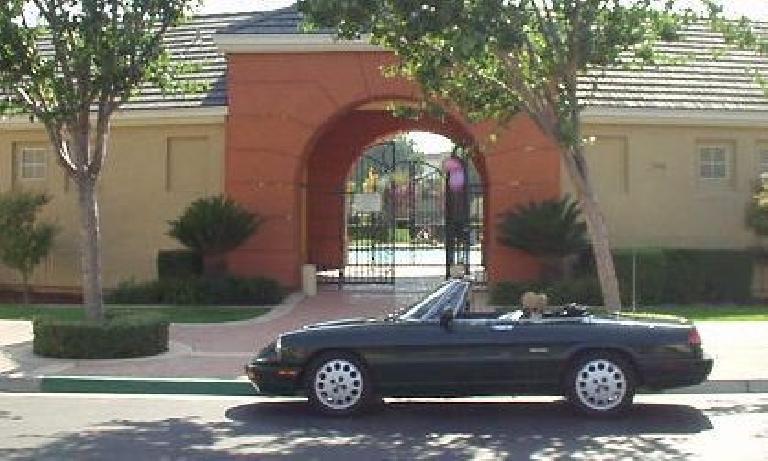 Elaina, feeling at home among the Mediterranean colors in Fremont, CA. (September 27, 2003)