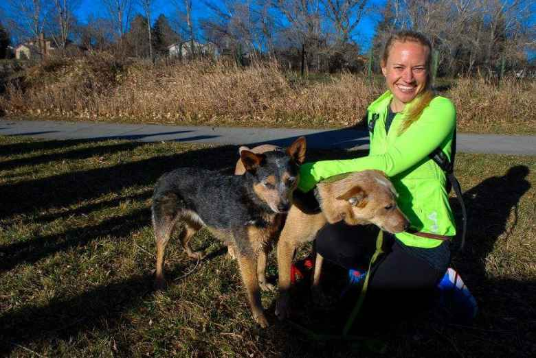 Amber and her dogs Hank and Bear after finishing the 2017 Turkey/Donut Predict 5k at Rolland Moore Park.