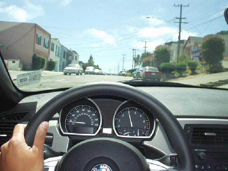 The view behind the cockpit of the Z4 while driving the streets of South San Francisco.