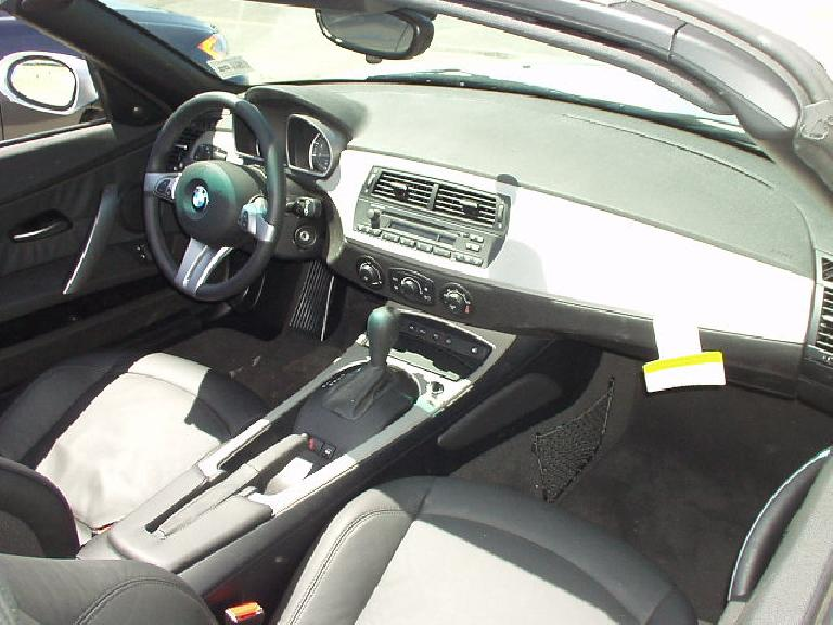 The interior -- while intended by BMW to be sleek and avante garde -- looked pretty ho-hum and less classic than my Z3's interior.  And then there was an automatic transmission... for shame...