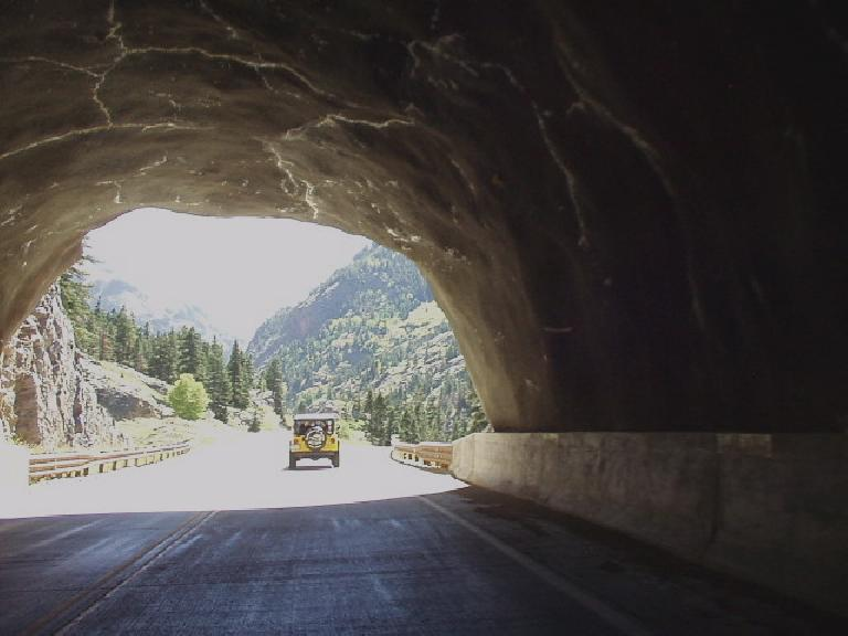 Following an Ouray Jeep Tours vehicle through a tunnel.