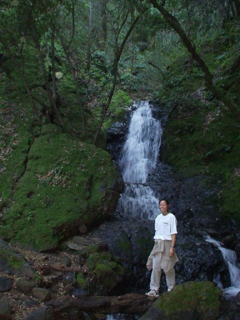 Evelyn in front of another waterfall.