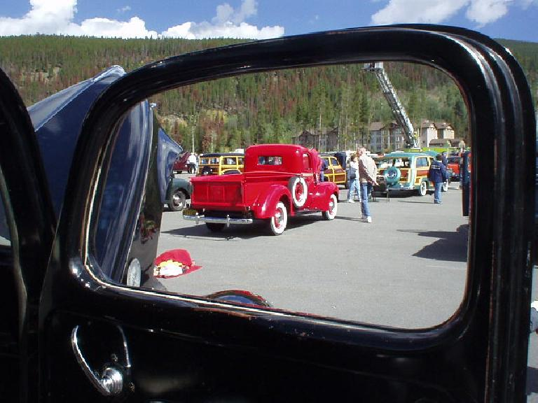 View of another Ford pickup through a door window.