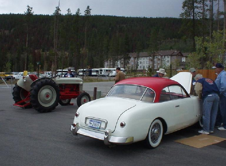 I really loved the white car, which was a Comete Monte-Carlo (a French Ford).  To the left of it is a Ford tractor.