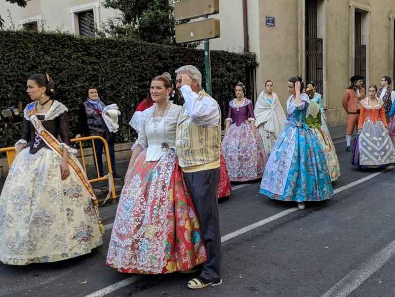 Women in elaborate dresses during Las Fallas.