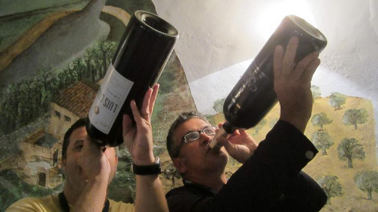 Jordi and Antonio taking a slug out of (empty) wine bottles. (August 26, 2013)