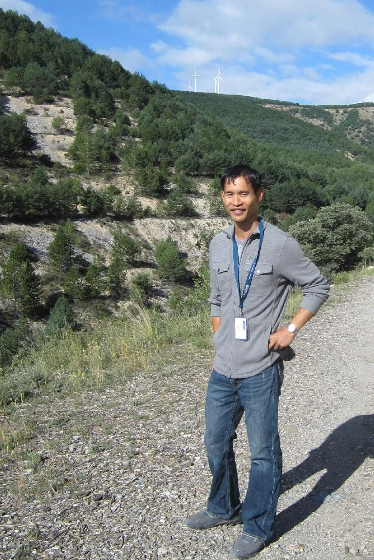 Felix Wong in front of a windmill during a one-to-one talk/walk. (August 26, 2013)