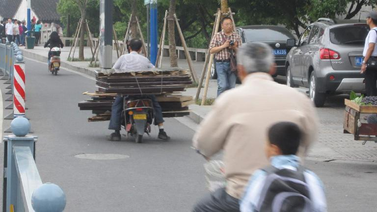 Carrying large pieces of wood on a motorbike in Suzhou. (May 17, 2014)
