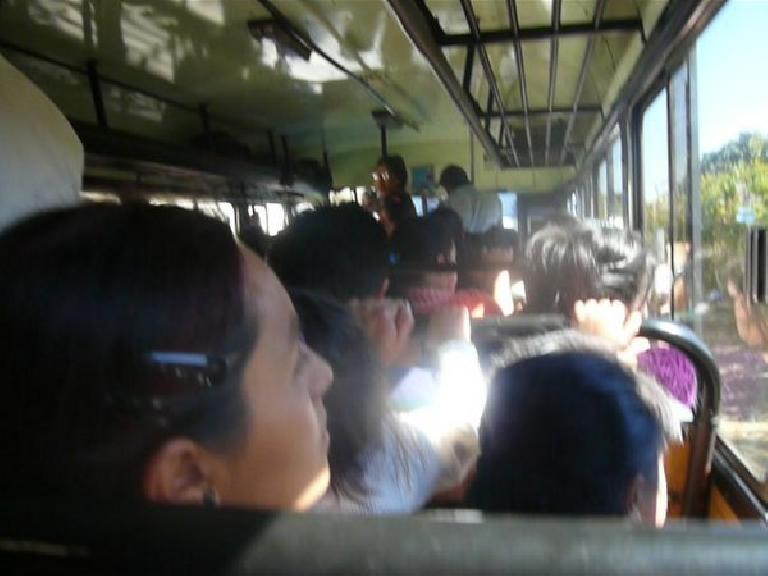 Riding the chicken bus from San Andres Itzapa to Aposentros. (January 7, 2011)