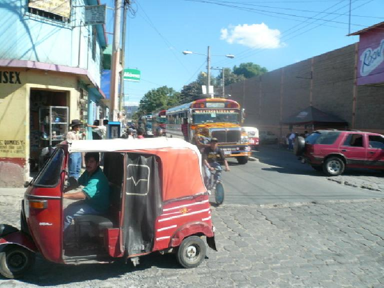 Another tuk-tuk and chicken bus.  These were in Chimaltenango. (December 31, 2010)