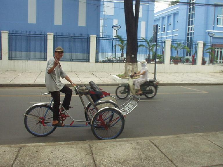 Cyclo guy stalking me by the Reunification Palace in Saigon.